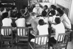 Dhaka 1967 - <p>Ralph Hegnauer at conference with volunteers in Dhaka.</p>
